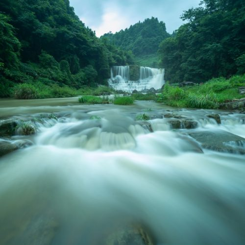 The waterfall is located in the beautiful natural environment of guizhou province